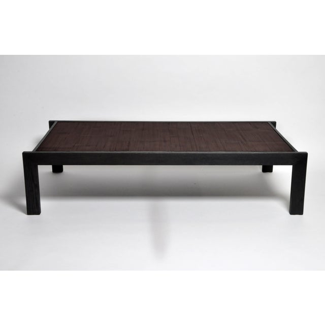 This large custom coffee table is made from a vintage Chinese opium mat. The mat has been affixed to a wooden panel and...