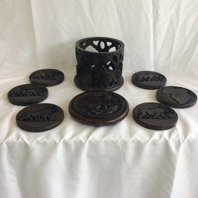 Set of 6 Indonesian wooden coasters with holder. Hand carved. Fun hipster barware.
