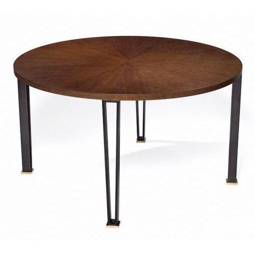 The Cooper Dining / Center Table by Studio Van den Akker is shown with a steel brushed Oak sunburst top with blackened...