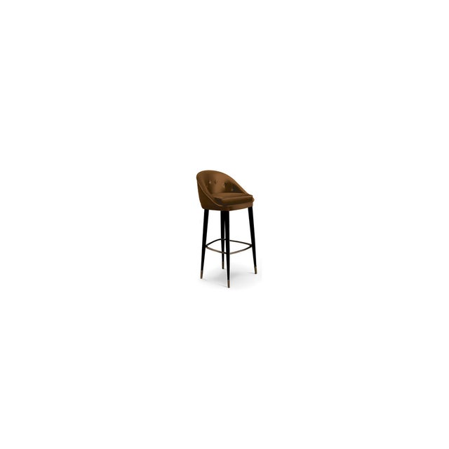 Classic in its silhouette, the lustrous curves of this bar stool complement those of the modern day woman. A glossy...