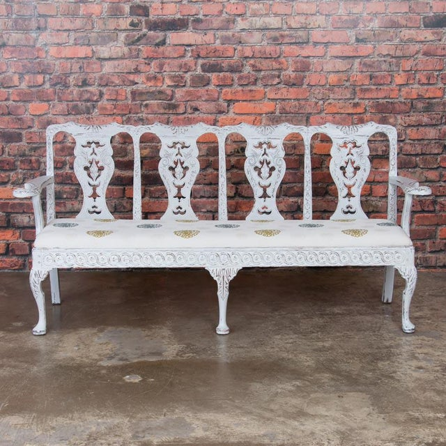The lovely, soft colors and traditional carving of the Gustavian period are well displayed in this exquisite bench. Where...