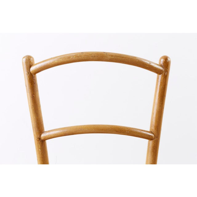 Rare pair of Austrian Viennese bentwood chairs produced by J. and J. John. handcrafted beechwood frames featuring a round...