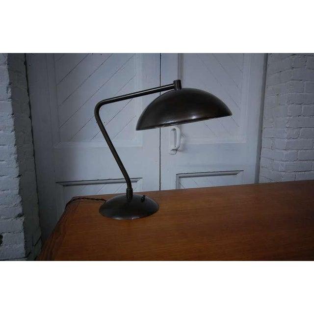 Desk lamp attributed to Kurt Versen, circa 1945, with bronzed finish.