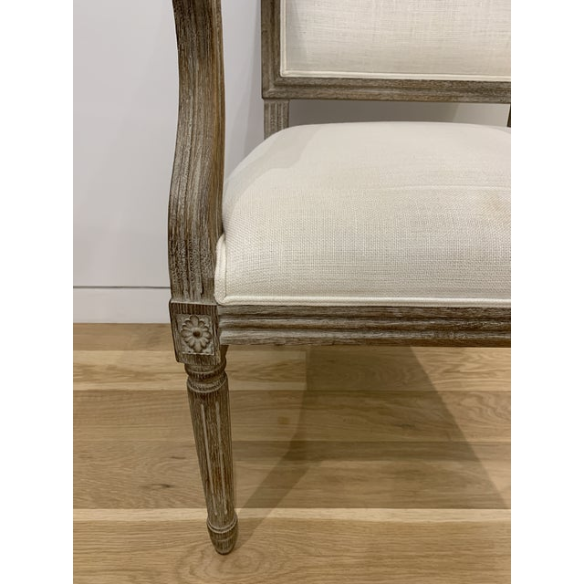 Restoration Hardware's reproductions of vintage French dining chairs display the elegant restraint emblematic of...
