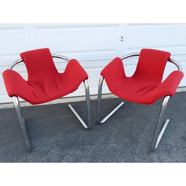 A pair of vintage chrome tube red sling seat chairs. Zermatt chairs by Duncan Burke and Gunter Eberle for Group. Italian...