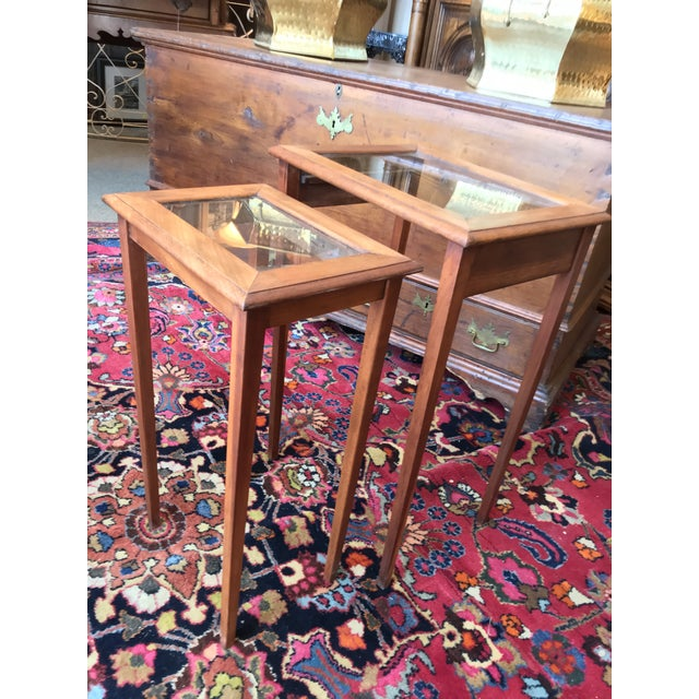 Here we have a set of two wood.and glass nesting tables c.1930's. They're in overall great condition with very minimal...
