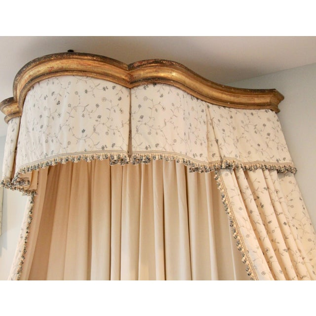 Beautiful Circa 19th Century Italian giltwood bed corona. Features newly made Chelsea Textiles Flowering Vine hand-...