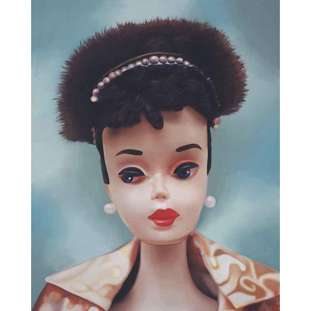 This oil painting features a beautiful 1960 Barbie! The glamour coat is a golden metallic brocade with a small floral...