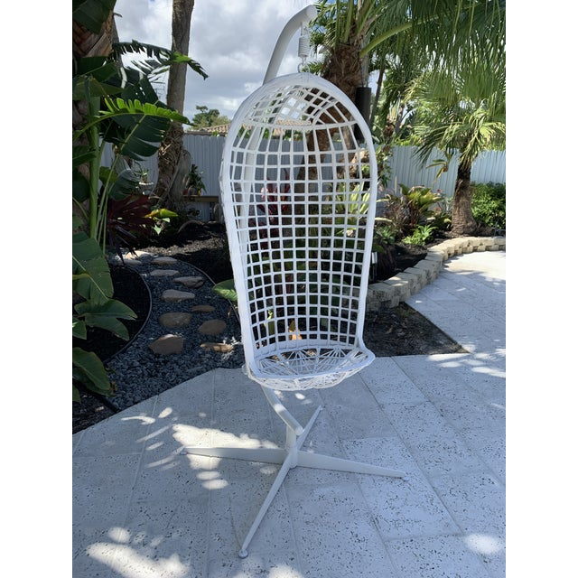 Super rare Russell Woodard spun fiberglass hanging birdcage swing from the 60' or 70's. Structurally sound with no breaks...