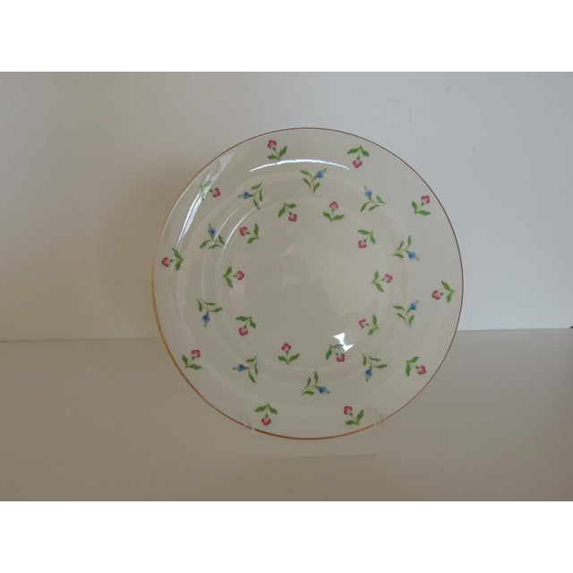 """Small red and pink flowers with green leaves and gold accent. Size: 8.5""""D x. 25""""H"""