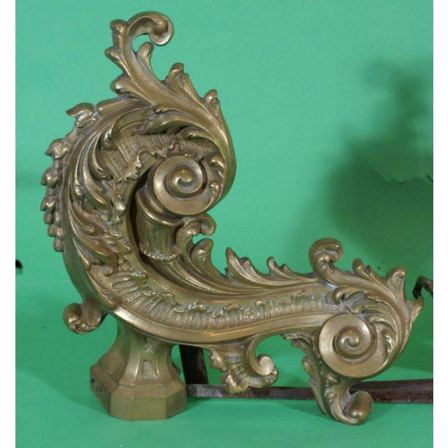 A pair of late 19th century French chenets / andirons. Wear to surfaces.