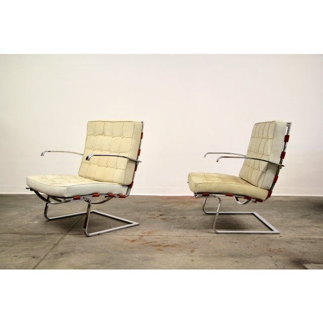 A wonderful pair of Model MR70 Tugendhat chairs designed by Mies van der Rohe and Lilly Reich, and Manufactured by Alivar,...