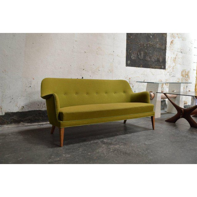 Mid-Century Scandinavian Modern sofa in the style of Carl Malmsten. Original upholstery still in excellent vintage...