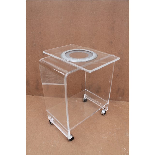 Amazing authentic Mid-Century lucite rolling bar cart or TV stand. This piece includes a functioning lazy susan top which...