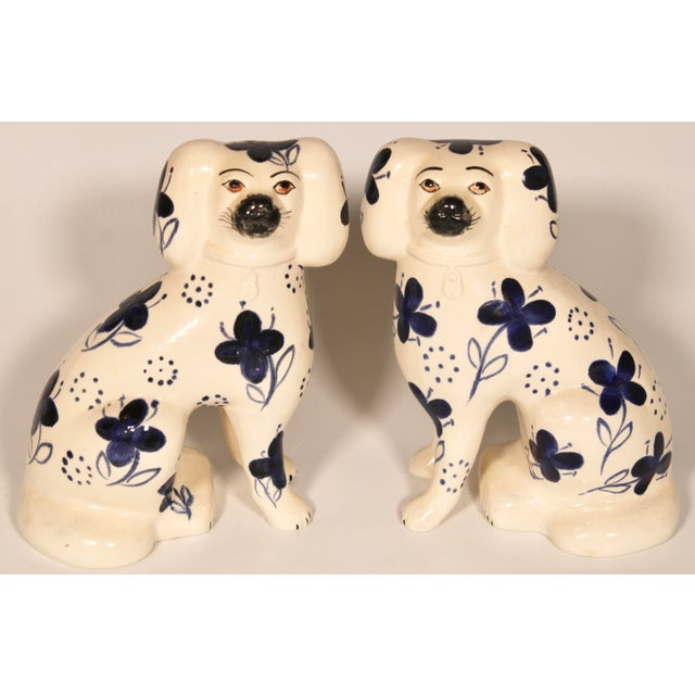 A lovely pair of blue and white Staffordshire Spaniels. The dogs are a large, attractive pair with a charming hand painted...