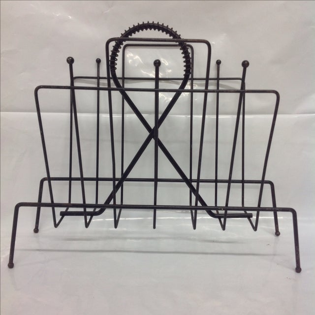 Fredrick Weinberg Mid Century Magazine Rack. Black with coil decor and ball tips.