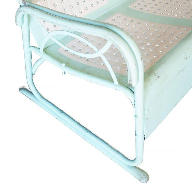Mid-Century Woodard style three person garden lounge made from a stamped sheet metal seat and a tubular steel frame. There...