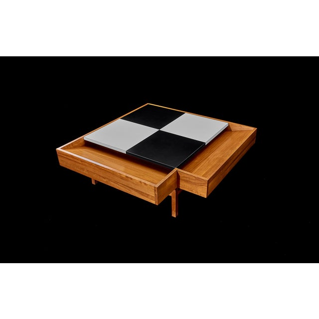 Brown Saltman Coffee Table designed by John Keal Walnut table with black and white checked formica surface opens to reveal...