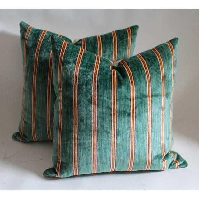 Pair of striped velvet pillows with linen backing, down and feather insert and zipper closure on bottom.