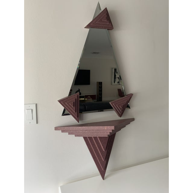 1980's Memphis design style mirror and matching shelf. The 80s may have been the last decade of true creativity and...