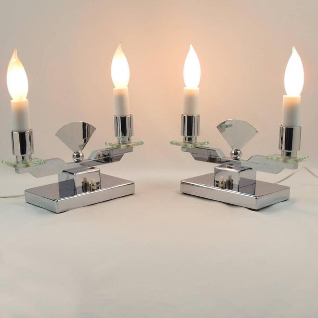 Charming and unusual pair of French Art Deco geometric twin faux candle lamps. Very refined candelabra style design with...