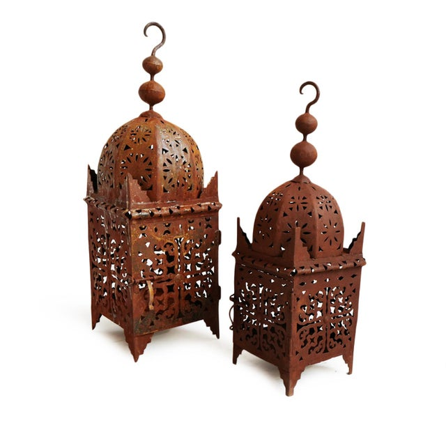 Traditional hand cut iron work Moroccan Kasbah lantern with rusted finish and beautiful floral and triangular patterns....