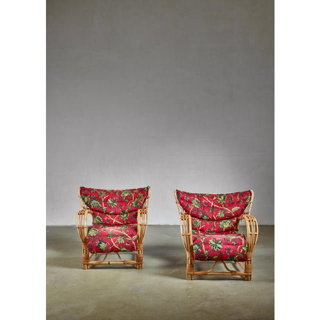 A gorgeous pair of Swedish lounge chairs made of bamboo and rattan and original cushions with a floral motif. The very...