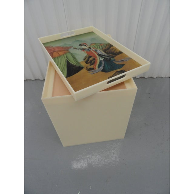 Custom acrylic table with removable top. The top contains an inserted piece of reverse glass painted art of an Asian...