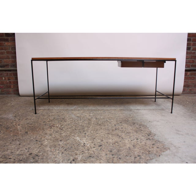 Uniquely sized table by Paul McCobb for Winchendon composed of a solid maple inset top and corresponding dual drawers with...