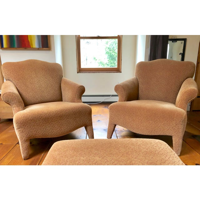 Similar to the Donghia Luciano chair, these fully upholstered neotraditional armchairs have many of the characteristic...