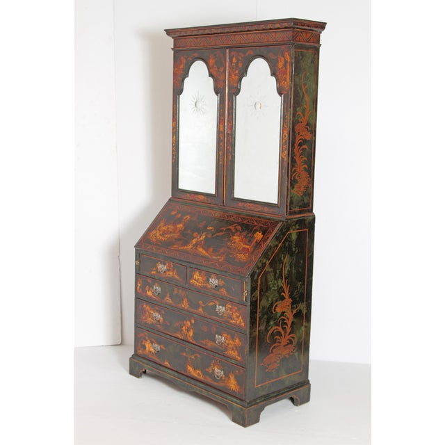 This early 20th Century five-drawer secretary is made of wood stained in a deep black color with chinoiserie. Adorning the...