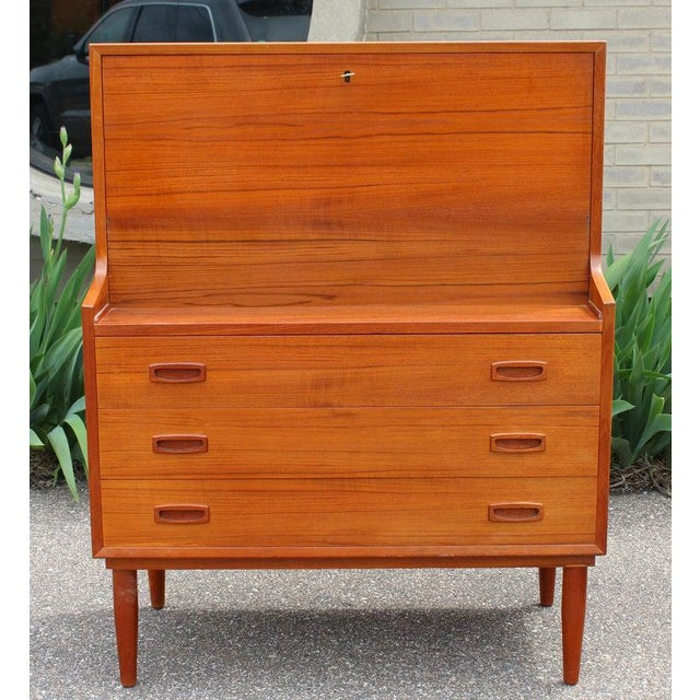 For your consideration is a magnificent, teak drop down desk secretary dresser made in Denmark, circa the 1960s. In...