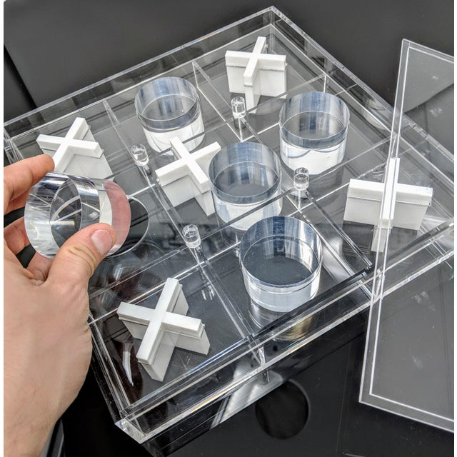 This is a fantastic lucite tic-tac-toe game piece would be perfect for a study or placed on an ottoman, coffee table or...