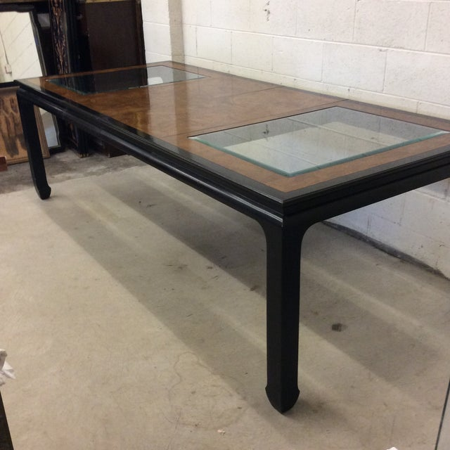This dining table is in excellent condition with only slight scuffs and blemishes. Burl wood is beautiful balance to the...