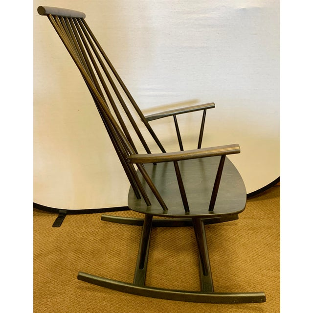 Coveted signed Danish Modern Möbler sculptural rocking chair. Iconic Danish modern classic in a dark mossy green color.....