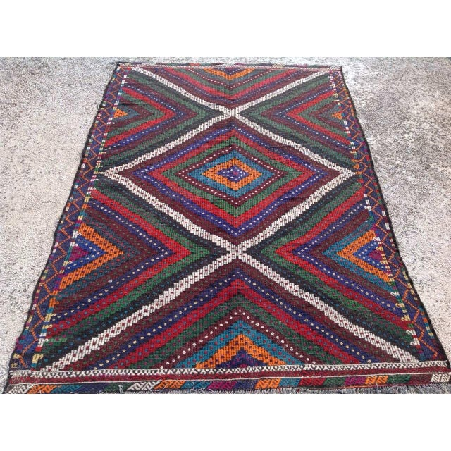 This beautiful, vintage, handwoven kilim is approximately 50 years old. It is handmade of very fine quality wool and...