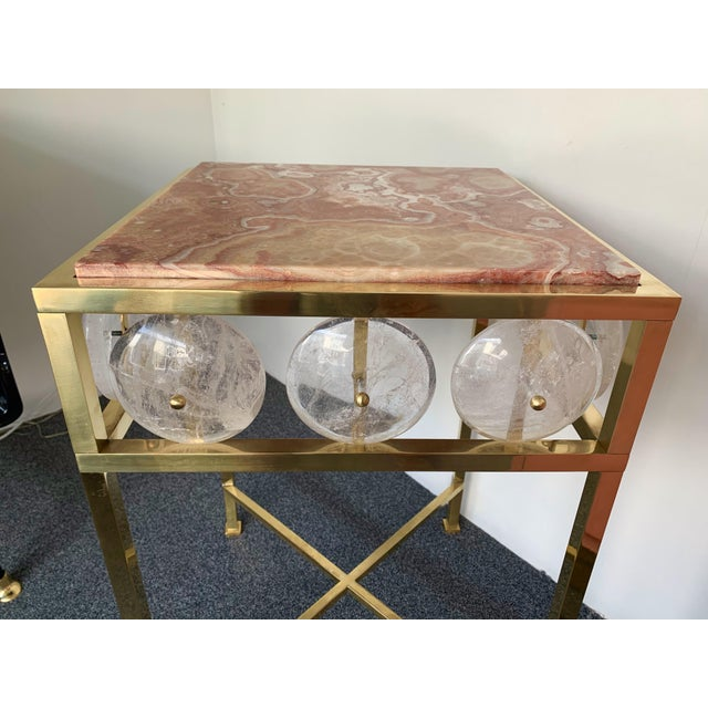 Contemporary pair of brass side end tables or night stands with large rock crystal pieces and rare red onyx top, different...