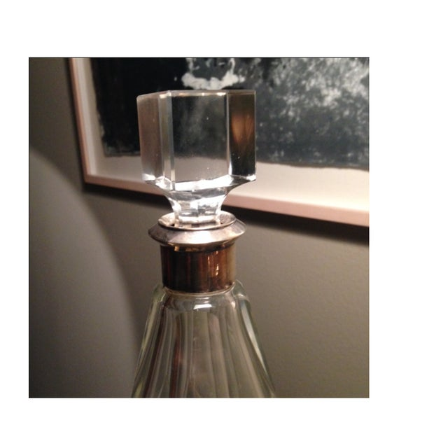 A set of Three glass decanters with silver trim on the top. All of them stunning and heavy duty. Purchased in 1995 from...