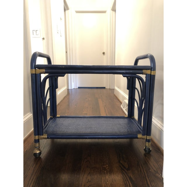 Beautiful vintage painted navy and gold rattan bar cart! This cart is sturdy and big enough for all of your storage and...