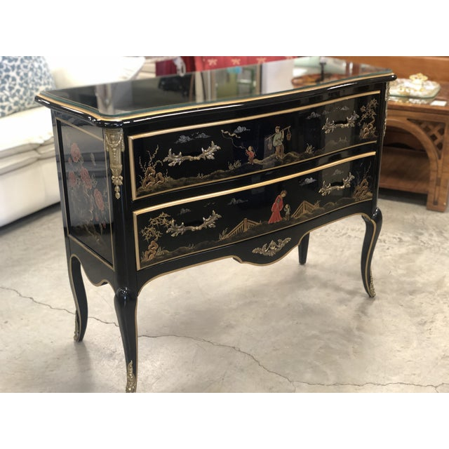 Gorgeous Chinoiserie French style chest of drawers! Black lacquered, hand painted, dovetail construction, with ornate...