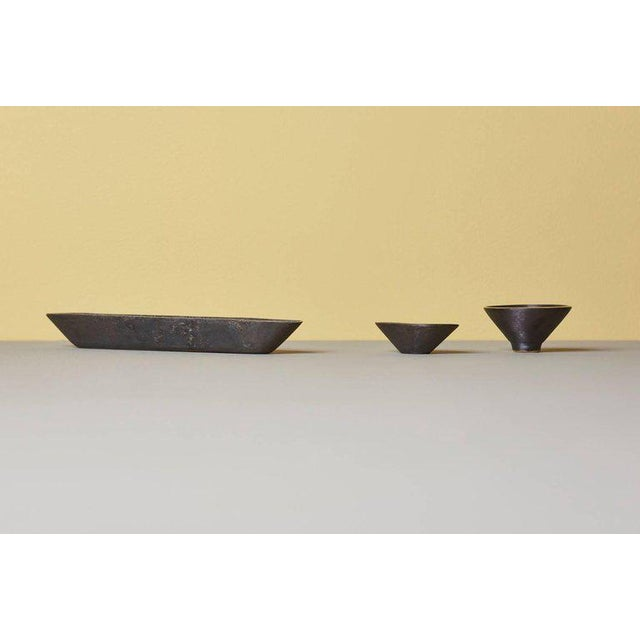 Set of three bowls by Carl Auböck #4279, #4280 and #4317 Measures: 28 cm x 5 cm x 3 cm 8 cm x 6 cm x 3 cm 4 cm x 7 cm...