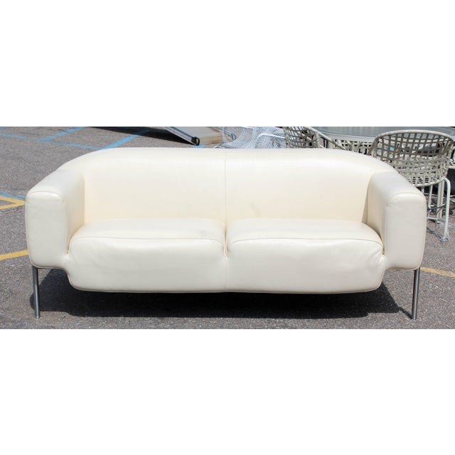 For your consideration is a fabulous, white leather sofa, on a steel frame. In excellent condition. Strong, heavy and...