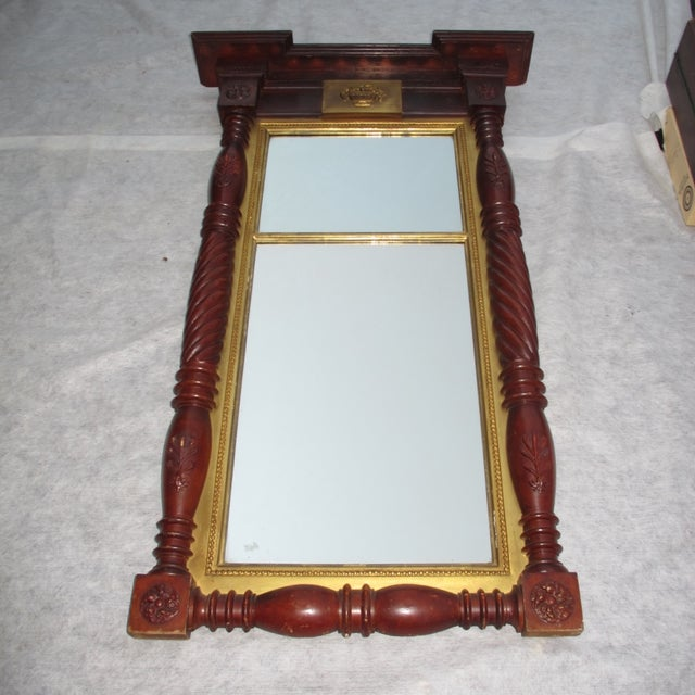 Large federal style mirror. Excellent cornice molding and outstanding turned pilasters. Mirror is lined with gold leaf...
