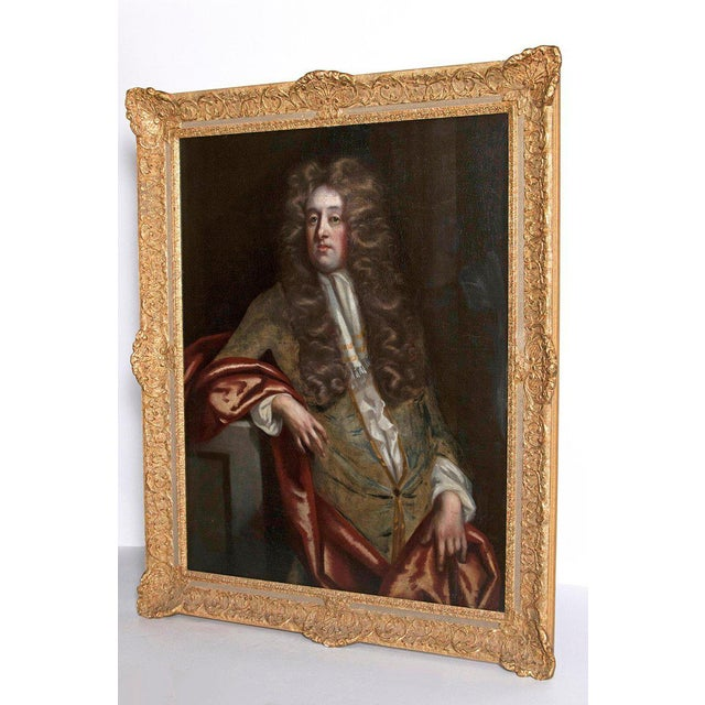 A very fine portrait of a seated gentleman. He is dressed in a gray coat with a white neck-cloth and a rose drape. Very...