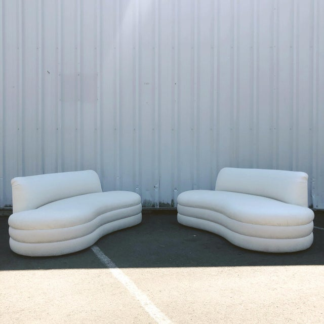 Exceptional curved couch pair after Vladamir Kagan. Two-toned abstract jacquard fabric with a slight sheen to it. A true...