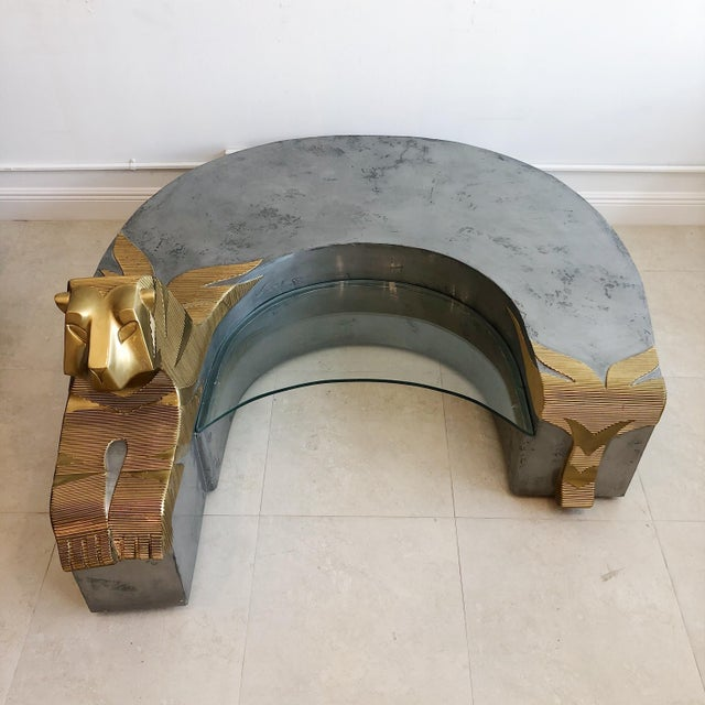 Large sculptural coffee table by artist Anne Herbst. Painted gold and silver table has glass insert and back portion can...