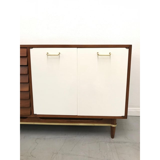 Stunning mid century modern credenza from American Of Martinsville's Dania collection designed by Merton Gershun. Credenza...