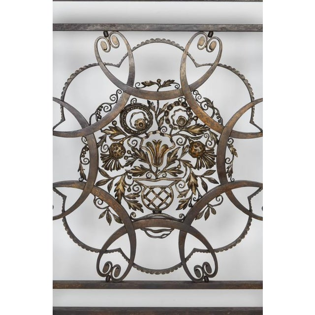 "Wrought iron firescreen by Raymond Subes. Measures: Height: 32.5"", width: 30"", depth: 9""."