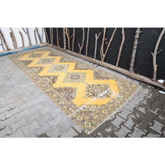 WIDE Vintage Turkish Hand-Knotted Runner Rug is a semi-antique vintage rug. '60s Eastern region of Turkey's unique rug is...