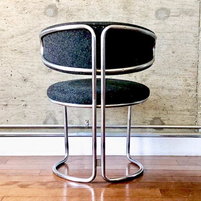 Vintage modernist chair with heavy metal frame. Original upholstery. This gorgeous vintage post-modern chair is...